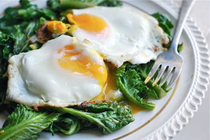 fried eggs and sauteed greens