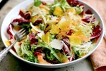 Seared cippolini onions lend depth to this jewel-toned radicchio and frisee salad with shaved beets and carrots.