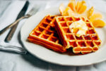 Decadent eggnog waffles make for an excellent holiday breakfast treat.
