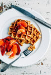 Make breakfast wonderful with this delicious sweet potato waffle recipe made with aromatic spices, cubed sweet potatoes, and nutty cornmeal.