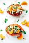 A decadent yet healthy loaded sweet potato recipe that's topped with tangelos, avocado, and haloumi