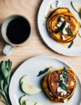 An autumnal sweet potato pancake recipe topped with fried sage leaves and crumbled goat cheese.