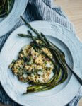 Creamy farro risotto (aka farrotto) with all the best spring things like ramps, young garlic, chives, and roasted asparagus.