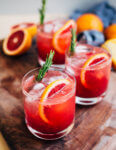 Refreshing non-alcoholic blood orange spritzers are an ideal sip for dry January or a new year reset. With fresh-squeezed blood orange juice and rosemary simple syrup, blood orange spritzer mocktails are a sunny counterpoint to January's chill.