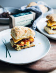 Perfect for a relaxed weekend or a holiday brunch, these layered biscuit sandwiches begin with airy homemade biscuits and are topped with thick-cut ham, slow-scrambled eggs, sharp cheddar, and a quick red onion jam.