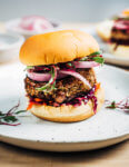 These vegetarian shiitake mushroom and tahini veggie burgers with a savory sweet red cabbage and carrot slaw, quick-pickles, and beet microgreens are a super flavorful, wonderfully satisfying dinner option.